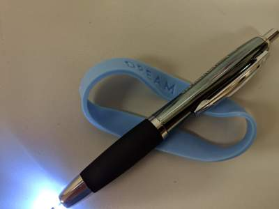 A lighted pen and rubber bracelet are useful for keeping a dream journal.